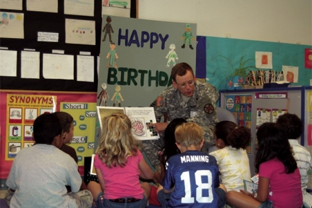 Col. Andy Bowes, Fort Eustis garrison commander, reads the book Happy Birthday U.S. Army, June 11 to the children in the kindergarten class at the Fort Eustis Child Development Center.