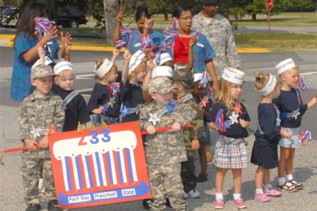 Children celebrate the Army's 233rd birthday by marching in a parade June 11 in front of the Fort Eustis Child Development Center.