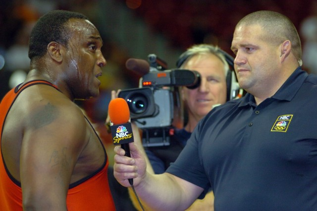 Two-time Olympic Greco-Roman heavyweight medalist Rulon Gardner (right), now a color analyst for MSNBC Sports, interviews Staff Sgt. Dremiel Byers, who secured a berth in the Beijing Games with a victory over U.S. Army World Class Athlete Program teammate Spc. Timothy Taylor in the U.S. Team Trials for Wrestling June 15 at the University of Nevada, Las Vegas' Thomas & Mack Center. Byers and Gardner trained together and battled for spots on two U.S. Olympic teams.
