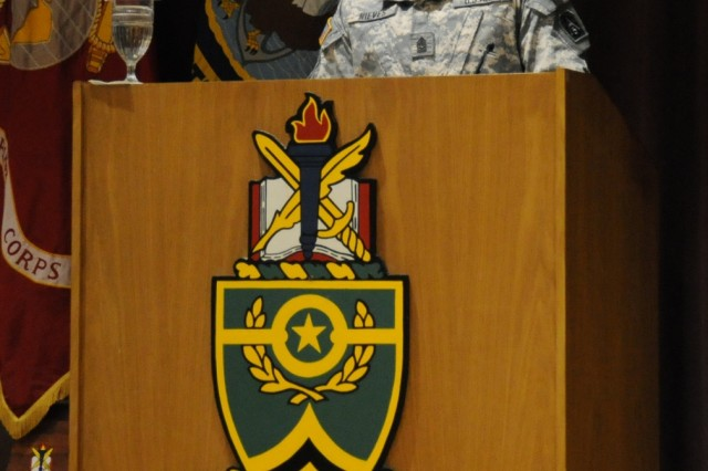 Guest speaker Command Sgt. Maj. George L. Nieves, U.S. Army North command sergeant major, congratulates Sergeants Major Nonresident Course Class 1-08 graduates during a ceremony June 20 in the U.S. Army Sergeants Major Academy East Auditorium, Fort Bliss, Texas.