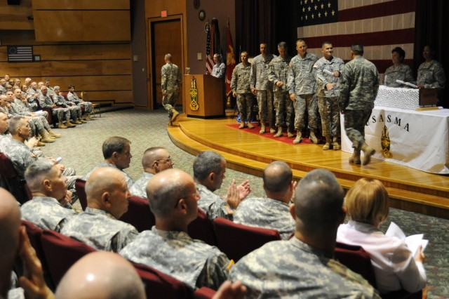 Sergeants Major Nonresident Course Class 1-08 graduates shook the hands of guest speaker Command Sgt. Maj. George L. Nieves, U.S. Army North command sergeant major, and the U.S. Army Sergeants Major Academy command group after receiving their diplomas during a graduation ceremony June 20, at the academy's East Auditorium, Fort Bliss, Texas.