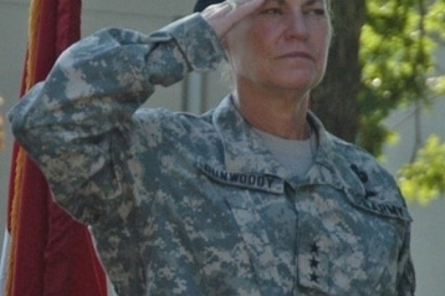 Lt. Gen. Ann E. Dunwoody salutes as the national anthem is played by the U.S. Army Materiel Command (AMC) band during Dunwoody's welcome ceremony as the AMC deputy commanding general on June 17 at AMC headquarters. On June 23, President George W. Bush nominated her for the rank of four-star general and commander of AMC.