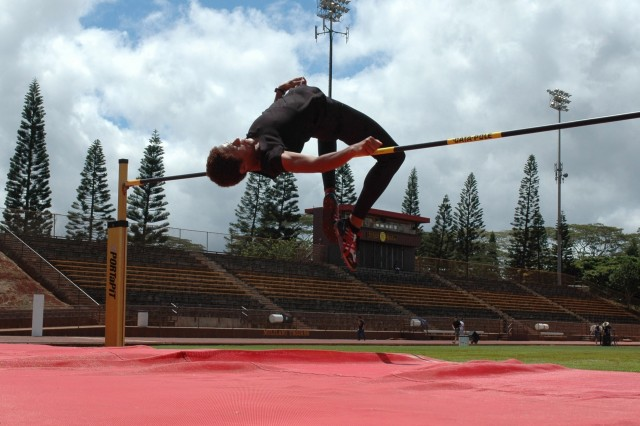 MILILANI, Hawaii - Adriane Stone leaps over the high jump crossbar during a practice session at Mililani High School. After a seven-year hiatus, Stone is back in form, recently qualifying for the U.S. Olympic track and field trials.