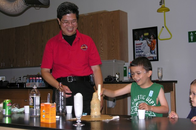Picatinny employee Doug Wong shows Maxwell, 6, how carbonated soda and breath mints create gas during a science experiment at the Liberty Science Center June 14.