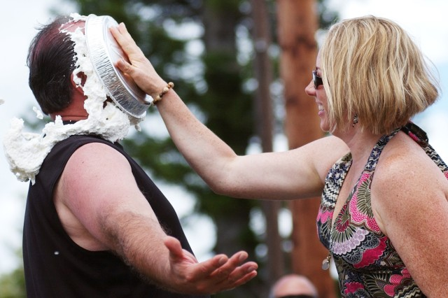 """Air Force Col. Louis A. Caporicci, Special Operations Command, Pacific deputy commander, gets """"pied"""" by Petty Officer 1st Class Jackie Murphy."""