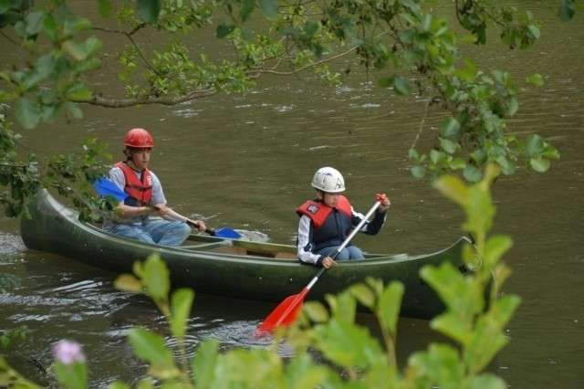 Alan Bywater, 14, of Heidelberg, paddles from the back of a canoe while David Dean, 12, of Wiesbaden, sits in the front. The two boys, whose dads are deployed from installations in Germany, participated in a sports and fitness camp as part of Installation Management Command-Europe's Camp A.R.M.Y Challenge.