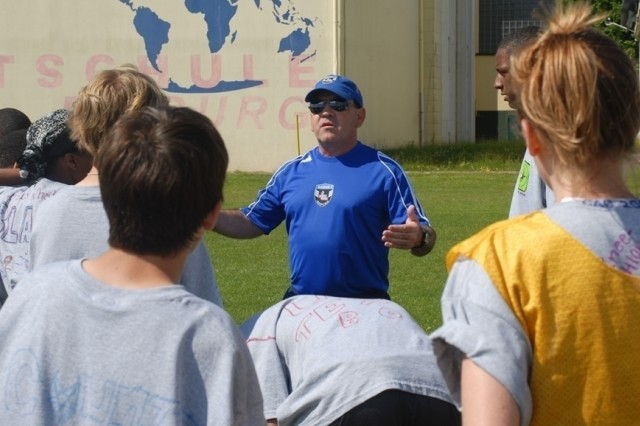 Keith Tabatznik talks fundamentals at the Camp A.R.M.Y. Challenges sports and fitness camp. Tabatznik was one of six members of the U.S. Olympic Development Program who attended the camp, which was held in Bitburg, Germany, for children of deployed servicemembers stationed in Europe.