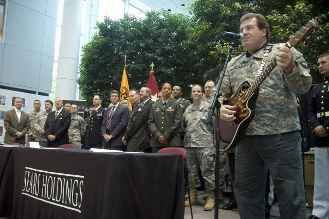 Joe Cantafio, 101st Rock Division and Chicagoland resident, performs at ceremony for a signing of a Statement of Support by the Sears Holding Corporation in Hoffamn Estates, IL, June 25, 2008.