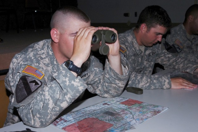 Staff Sgt. Travis Morrow, originally from Sauccentre, Minn. and assigned to 1st Battalion, 8th Cavalry Regiment, 2nd Brigade Combat Team, 1st Cavalry Division,  looks through binoculars while simulating a call for fire mission during the brigade's fire support recertification course at Fort Hood June 11.