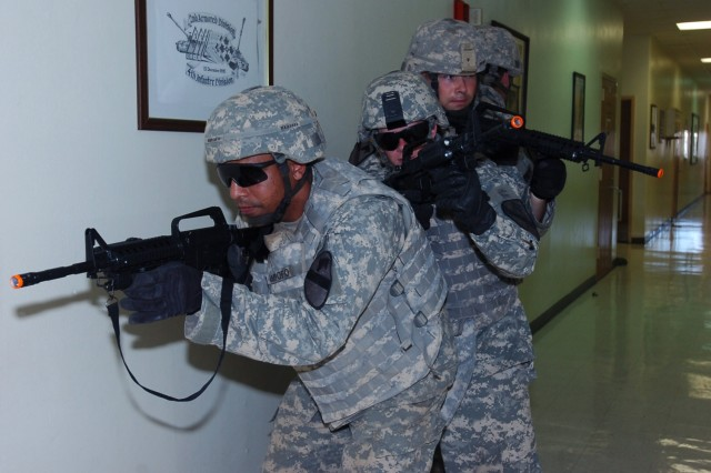 Sgt Brandon Ampofo, a native of Ft. Worth, Texas who is assigned to 1st Battalion, 8th Cavalry Regiment, 2nd Brigade Combat Team, 1st Cavalry Division, prepares to lead a team of fisters during room-clearing training, which was part of the brigade's fire support recertification course at Fort Hood June 11.