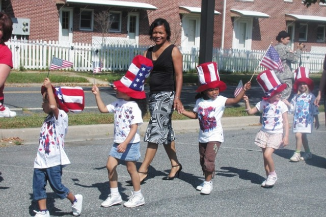 From left, Imani Pabon, 4; Aliza Pino, 4; Queen Wimberly with daughter Janaiya Wimberly, 4; Anya Chervak, 4; and Marie Fahlsing, 4, dressed in patriotic hats and colors, parade around the Edgewood Area Child Development Center to celebrate the Army's 233rd Birthday June 10.