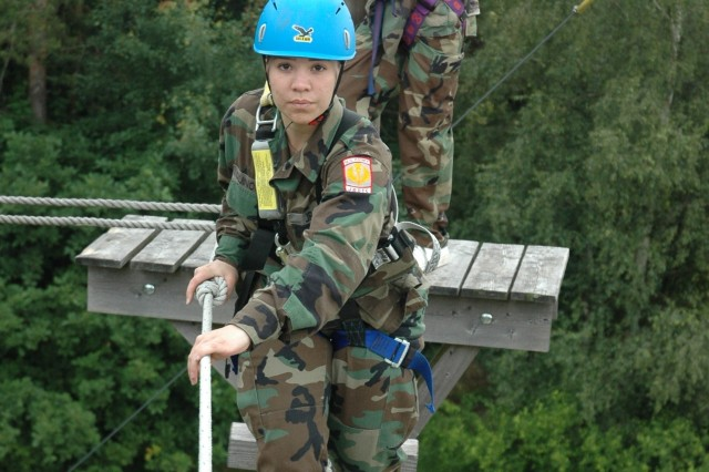 Army Cadets Viary Quinones, Ansbach HS, and John Bradley, Mannheim HS, cross a bridge 30 feet off the ground at the High Ropes Course in Taennesberg, Germany. The cadets are attending the 2008 DoDDS-Europe JROTC Cadet Leadership Challenge in Grafenwoehr, Germany.