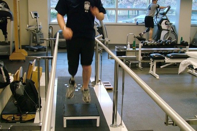 Spc. Nicholas Williams, who was wounded in Iraq in July 2007, works out with his new prosthetic leg at WRAMC s Military Advanced Training Center, which opened in September 2007.