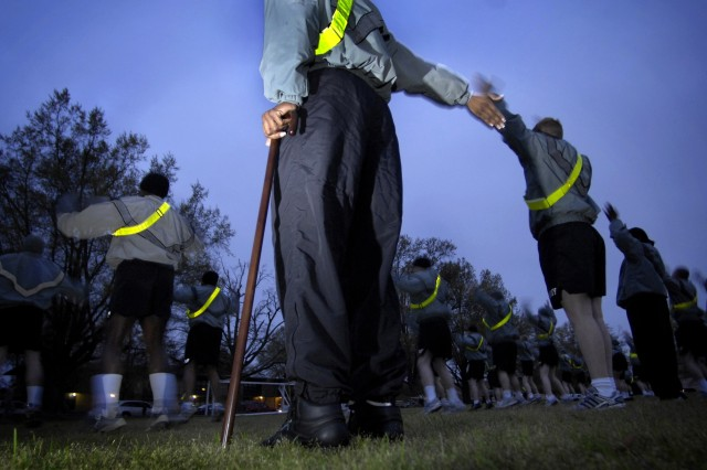 Soldiers assigned to the WTB participate in morning physical training. The Soldiers are recovering from wounds and injuries suffered in the line of duty.