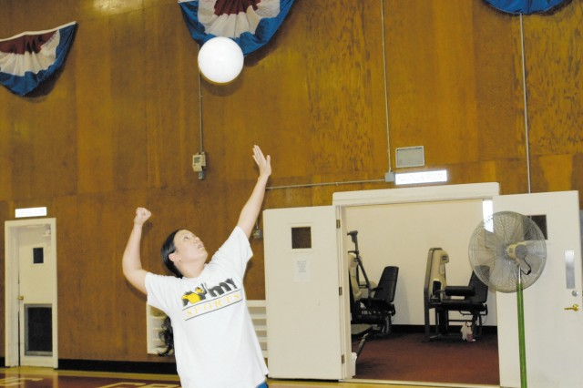 Sgt. Elizabeth Thompson, a preventive medicine specialist with the 1st Area Medical Laboratory, practices for the All-Army Volleyball Team at Hoyle Gym on Aberdeen Proving Ground.