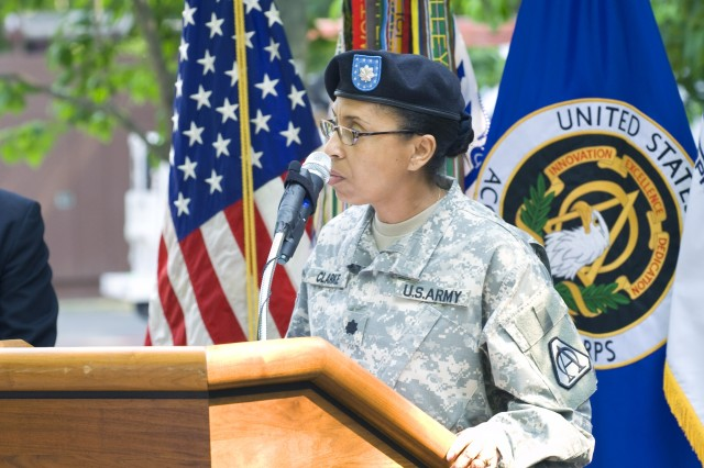 Lt. Col. Gail Clarke gives the invocation at a ceremony marking both a change in the operating charter for the Army Knowledge Online / Defense Knowledge Online Project Office, and a change in leadership as Col. Earl Noble assumes leadership and Col. James Barrineau bids farewell.