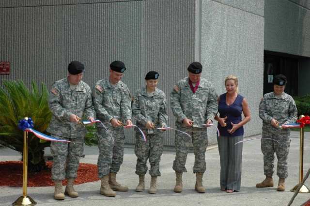 Col. John Collins, Fort Stewart's Army Medical Department Activity Commander; Brig. Gen. Donald Bradshaw, Southeast Regional Medical Command Commanding General; Capt. Kelly Yard, 385th Military Police Battalion and Fort Stewart's first refractive surgery patient; Maj. Gen. Rick Lynch, 3rd Infantry Division Commanding General; Sarah Lynch and Lt. Col. Ava Huchun, chief of ophthalmology at Winn Army Community Hospital cut the ribbon at the new Warfighter Refractive Eye Surgery Program Center at Fort Stewart, June 23.