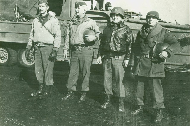 Image shows Donovan [second from left] with Lt. General Mark Clark, commander U.S. Fifth Army, on the left. (William J Donovan Photograph Collection).