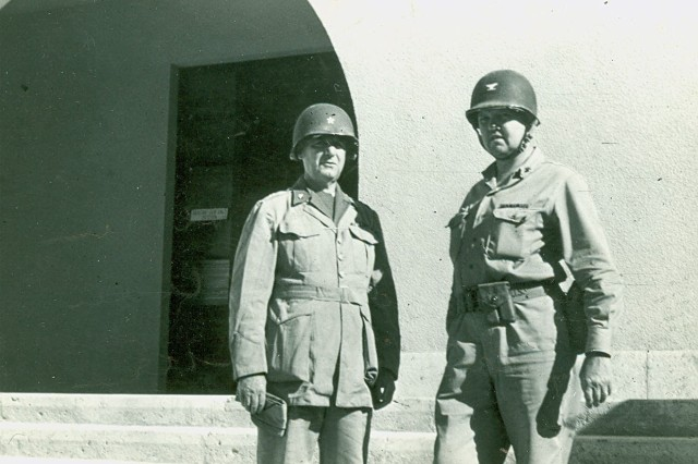 Then Brigadier General Donavan with a Colonel Eddy outside a captured  Italian headquarters on an airfield in Itlay. (William J. Donavan Photograph Collection).