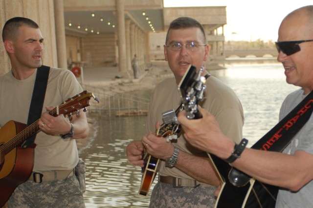 Maj. Steve Howell, force generation officer, Multi-National Corps-Iraq , Lt. Col. Greg Rawlings, Force Management Division chief, MNCI, and Chaplain Mike Charles, 10th Mountain Division, jazz out while performing at the Joint Visitor Bureau June 24. The group welcomes everyone to practice and 'pick' at their Friday night jam sessions at Building 24F, the mini chapel, at 9 p.m.