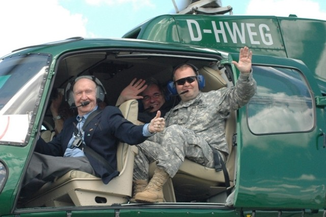 Retired Col. Gail Halvorsen, left, and Col. Ray Graham, commander of U.S. Army Garrison Wiesbaden, Germany, take off to drop candy during an open house celebrating the 60th anniversary of the Berlin Airlift at Wiesbaden Army Airfield June 29, 2008.