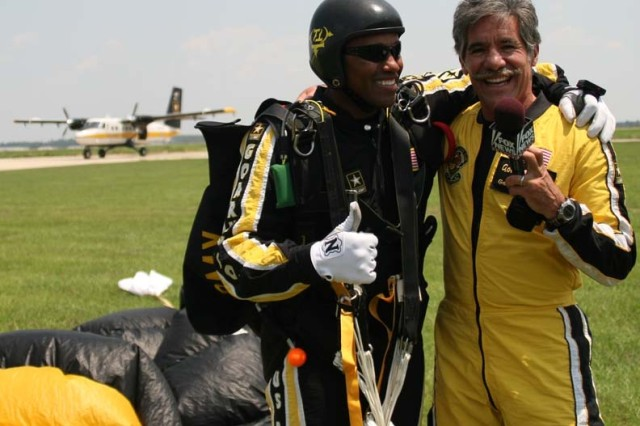 SFC Mike Elliott takes a moment to talk with Geraldo Rivera. Elliott was the tandem instructor for Rivera's sky dive with the U.S. Army Parachute Team.