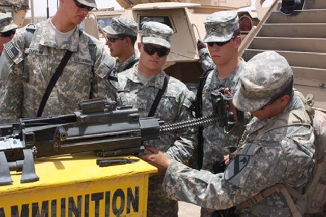 Soldiers from Troop A, 2nd Squadron, 7th Cavalry Regiment, in Staff Sgt. Steven Roode's squad assemble an M2 - .50 caliber machine gun during a tactical training class in Tallil, Iraq June 24.