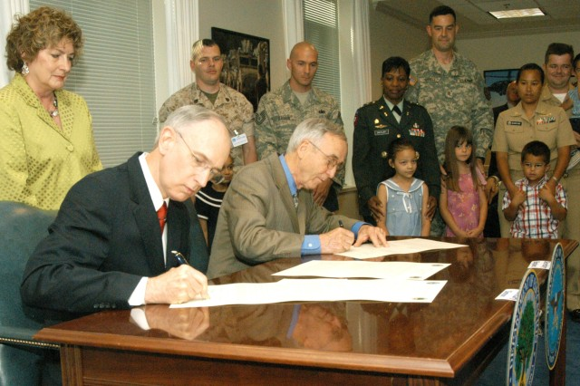 Deputy Secretary of Defense Gordon England and Deputy Secretary of Education Raymond Simon signed a Memorandum of Understanding at the Pentagon June 25 to address the unique challenges military children face as they transition from one school to another as their parents are assigned to different installations.