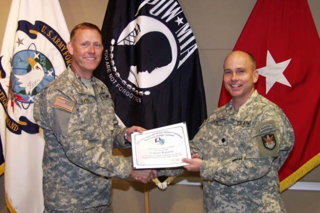 Col. Timothy Coffin, commander of the 1st Space Brigade, presents Lt. Col. Thomas James, commander of the 1st Space Battalion, with a safety certificate on behalf of SMDC/ARSTRAT commanding general, Lt. Gen. Kevin T. Campbell. The certificate was presented to recognize 12 months without a Class A, B or C accident in the battalion.