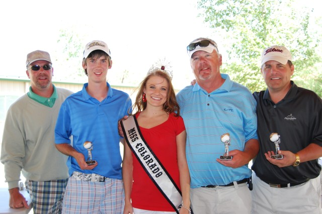 Tournament champions Rick Tarasiewicz, Nick Tarasiewicz, Tom Callaghan and Will Peters from the Joint Functional Component Command-Integrated Missile Defense receive their trophies from Miss Colorado Galaxy, Amanda Kepple.