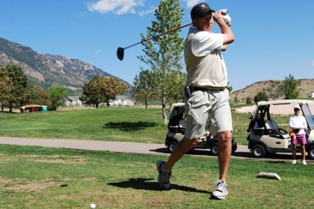 Gordon Baxendale of the G-3 Operations takes a practice swing at the 2008 U.S. Army Space and Missile Defense Command/Army Forces Strategic Command Annual Golf Tournament.
