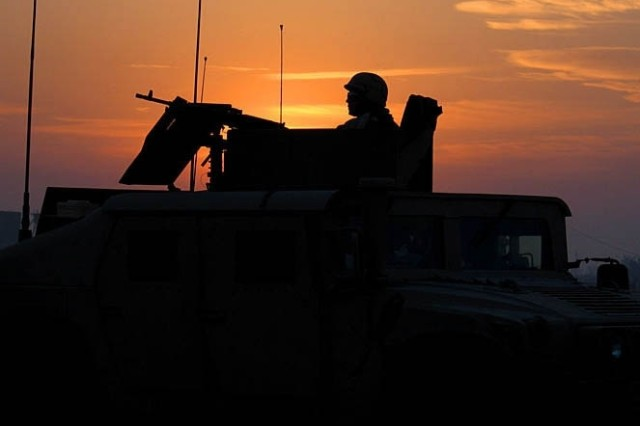 """An """"Ironhorse"""" Soldier from the 1st Brigade Combat Team, 1st Cavalry Division, patrols Salman Pak, Iraq, in January 2005.  The BCT will return to Iraq in early 2009."""