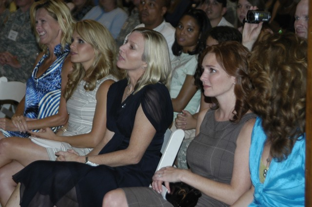 "From left: executive producer Deborah Spera, actress Sally Pressman, Lee Woodruff (wife of ABC correspondence Bob Woodruff) and actress Brigid Brannagh attend an exclusive screening event of Lifetime's drama series ""Army Wives"" Tuesday at Walter Reed Army Medical Center."