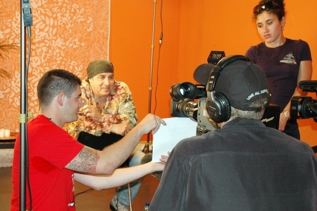Steve Van Zandt, a member of Bruce Springsteen's E Street Band, records a spot for American Forces Network-Europe before a June 25 show in Milan, Italy, in which the guitarist/actor invited four Soldiers of the Warrior Transition Unit in Vicenza, Italy, to attend.