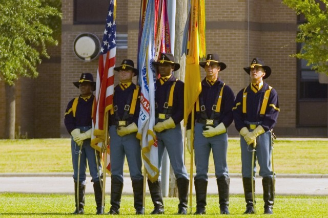 The Color Guard of the 1st Cavalry Division, prepares to present the 'Colors' during the 1st Cavalry Division's Distinguished Service and Welcome Ceremony July 1, held on Cooper Field at Fort Hood, Texas. Retirees and division volunteers were recognized for their efforts and exemplary service to the division and the United States Army.