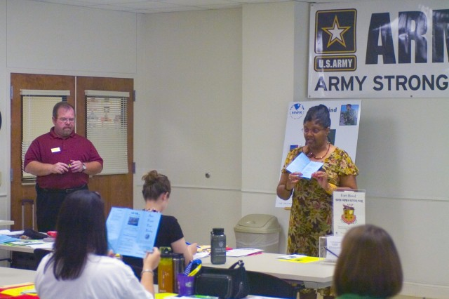 Beverly Haywood (right), Army Family Action Program specialist, and Mark G. Bauman, ACS Mobilization and deployment liaison for the National Guard and Reserve teach the level 1 AFTB (Army Family Team Building) class to a group of Soldiers and Spouses July 2 on Fort Hood, Texas. The AFTB training focuses on preparing everyone in 'America's Army' to function at the highest level with minimal outside support, while improving personal and family preparedness for deployments.