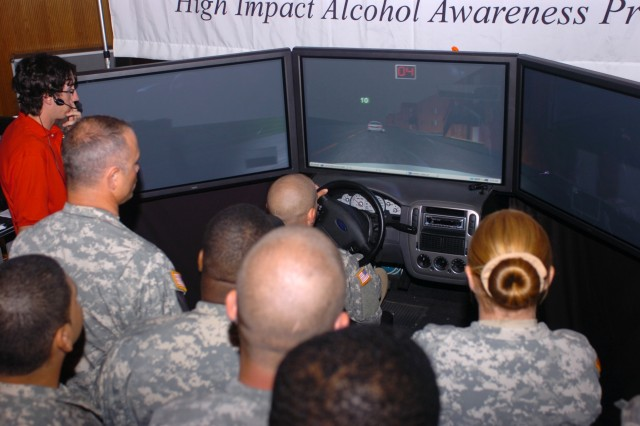 Soldiers from the Division Special Troops Battalion, 1st Cavalry Division wait in line to get their opportunity to drive a drunk driving simulator June 27 at Fort Hood, Texas during the 'Save A Life Tour,' a program that informs the public about the serious consequences of drinking and driving.