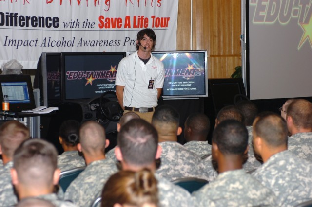 Brian Bedelgya, tour manager and event facilitator for the national 'Save A Life Tour, speaks to Soldiers from the Division Special Troops Battalion, 1st Cavalry Division about the serious consequences of drinking and driving June 27 at Fort Hood, Texas.  The 'Save A Life Tour' is a program that uses a multi-million dollar simulator, displays and a video presentations to inform the public about the dangers of drinking and driving.