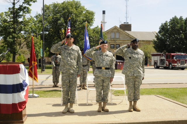 Command Sgt. Maj. Stephen D. Blake, Maj. Gen. Robert M. Radin, and Command Sgt. Maj. Norberto D. Osbourne salute the colors during the change of responsibility.