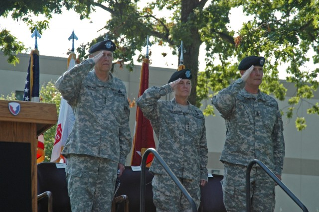 Gen. Benjamin S. Griffin, Lt. Gen. (P) Ann E. Dunwoody and Command Sgt. Maj. Jeffrey J. Mellinger salute as the national anthem is played by the AMC band during Dunwoody's welcome ceremony June 17 at AMC headquarters.