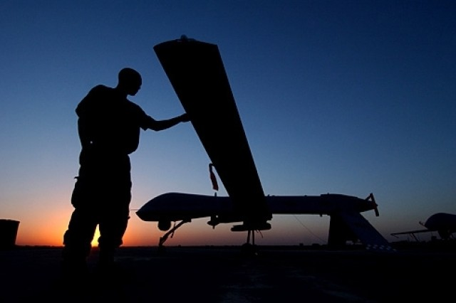 A crew chief from the 46th Expeditionary Reconnaissance Squadron completes post flight inspections of an RQ-1 Predator, Sept. 15, 2004, at Balad Air Base, Iraq. The Predator is a remotely piloted vehicle that provides real-time surveillance imagery. U.S. Air Force photo by
