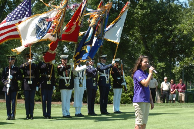 """Anna Nicholson, 14, sings the Aca,!A""""The Star-Spangled BannerAca,!A? as a Joint Services Honor Guard presents the colors during the opening ceremonies of the second-annual Earl Woods Memorial Pro-Am."""