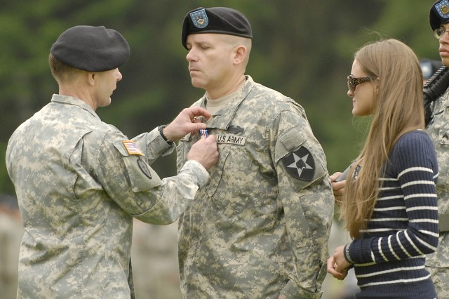 Lt. Gen. Charles H. Jacoby Jr. pins the Silver Star on Spc. Rodny Yefune of 2-23 Inf. while Courtney Runyon looks on. Runyon was presented a Bronze Star Medal for valor that was posthumously awarded to her husband Cpl. Luke Runyon also of 2-23 Inf.