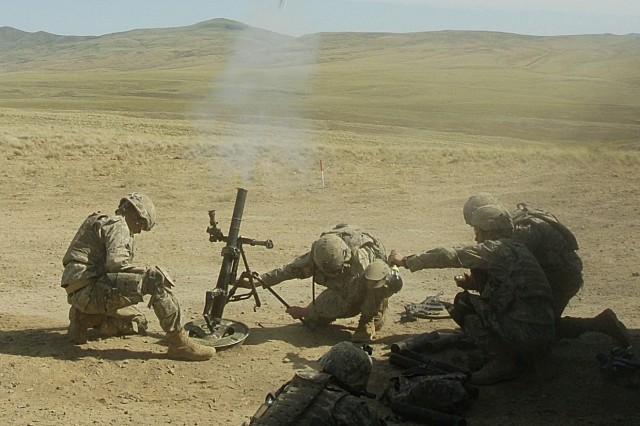 Soldiers from  C Co. 2-3 Inf. fire a 60mm mortar during a platoon live-fire exercise at the Yakima Training Center.