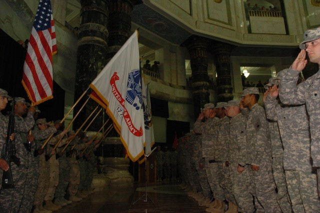 Servicemembers pledge to protect the ideals of the Constitution during the reenlistment ceremony and 4th of July celebration in the Al Faw Palace rotunda in Camp Victory, Baghdad. Airmen, Marines, sailors and Soldiers dedicated more than 5,500 years of additional service at this ceremony.
