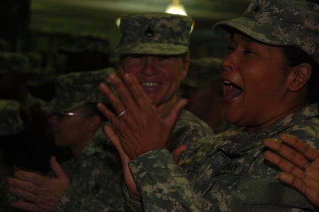 An Army sergeant celebrates after re-enlisting in the Al Faw Palace rotunda in Camp Victory, Baghdad, 4 July 2008. According to Command Sgt, Maj. Marvin L. Hill, command sergeant major, Multi-National Forces - Iraq, this is the largest re-enlistment ceremony since the all-volunteer force began in 1973.