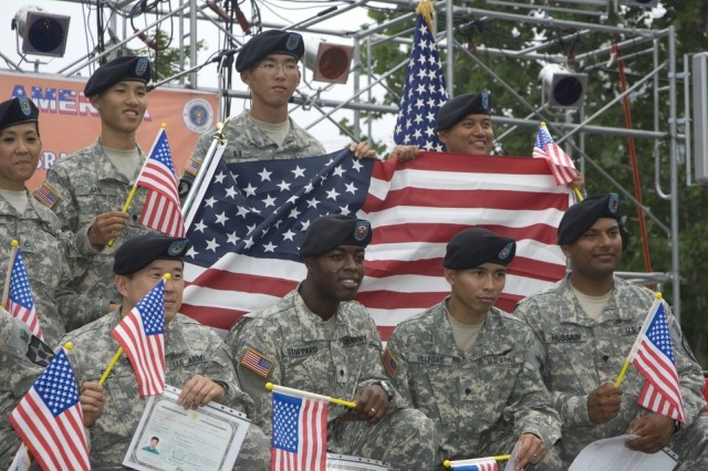 YONGSAN GARRISON, Republic of Korea - Yongsan-based Soldiers pose with Old Glory after a July Fourth naturalization ceremony in which they became some of the country's newest citizens. Seventeen Soldiers took the oath of allegiance during a ceremony that was part of July Fourth Festival activities here.