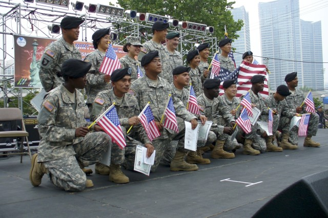 America's newest citizens pose after taking the oath of allegiance July 4 at a USAG-Yongsan ceremony in Seoul, Republic of Korea.