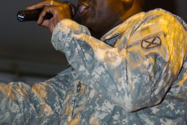 "Master Sergeant Isaac Alexis, of Houston, performs, ""We Gotta Go,"" a song about Soldiers leaving their homes to serve in Iraq, during an open mike night at the Camp Liberty MWR center June 8."
