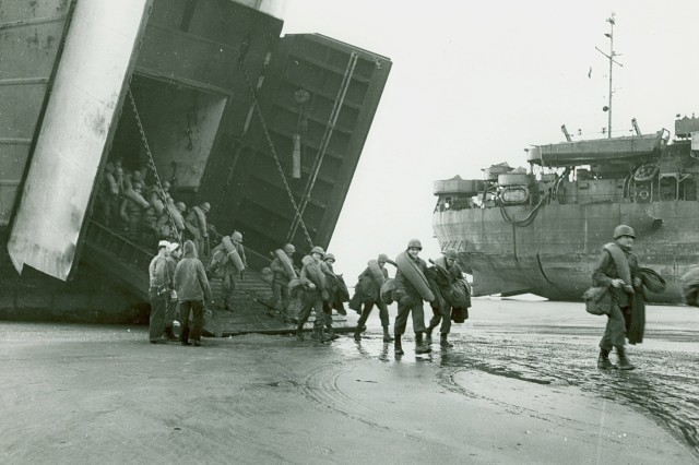 U. S. Army soldiers disembark from an LST on the beach at Le Harve, France just after the harbor was cleared of mines and beach obstacles were removed; November 16, 1944 (WWII Signal Corps Photograph Collection).